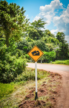 Steep grade hill traffic sign / Warning road sign uphill in the curve roadside countryside