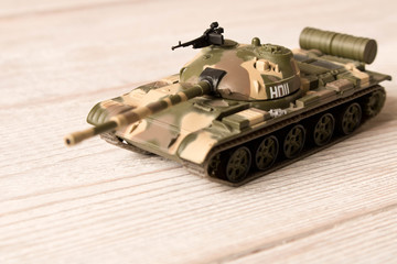 Toy model of the Soviet tank on a wooden table.