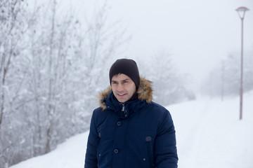 Man walking on snow in park