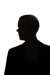 Silhouette of beautiful bald girl on white background