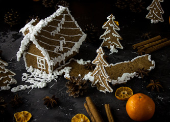 Gingerbread house on black night background, ginger cookies christmas dark photo