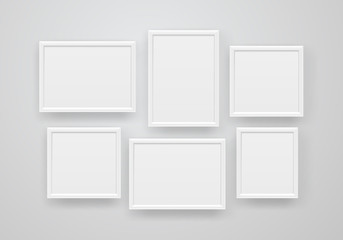 Empty white frames on a wall. Vector illustration