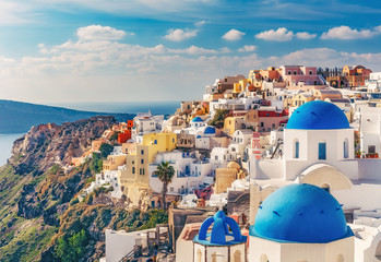 Wall Mural - Churches in Oia, Santorini island in Greece, on a sunny day. Scenic travel background.