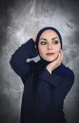 Beautiful young arab woman in traditional dress in the studio.
