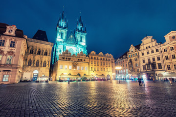 Old town with Tyn church in Prague, Czech republic, at night. Colourful skyline.