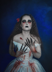 Beautiful woman in gothic style with bloody tears. Halloween scene