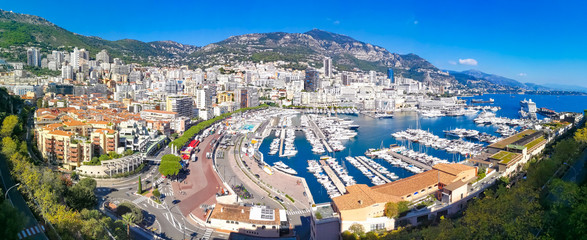 Aerial panoramic view over Monaco city, Generic architecture around seaside and famous port in summer holiday