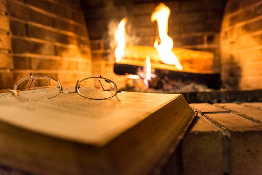 open book beside fireplace