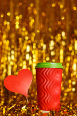 Coffee in red cup with red heart and Christmas golden metafan