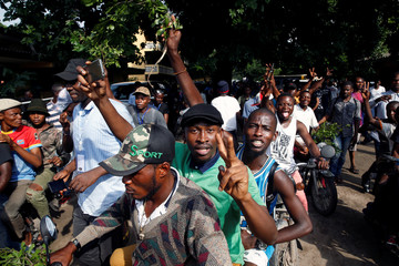 Supporters of Felix Tshisekedi celebrate after he cast his ballot at a polling station in Kinshasa