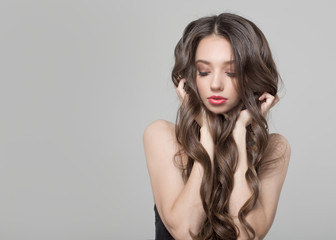 Fashion woman with beautiful long and curly hair. Woman with beautiful makeup and hairdo