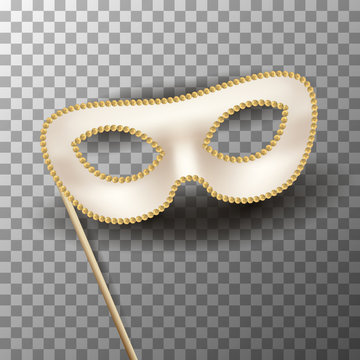 Beige carnival mask with gold decor on transparent
