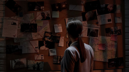 Fototapeta Woman detective searching terrorist act connections, figuring out danger place obraz