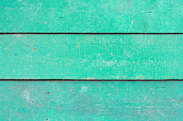 Texture background of wooden planks covered with old peeling paint