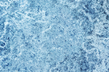 Abstract grunge dirty scratched concrete wall decorative winter blue color with frozen ice look background.