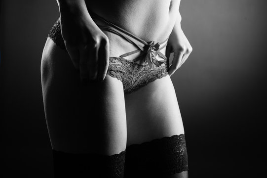 Girl in black sexy lingerie on black background