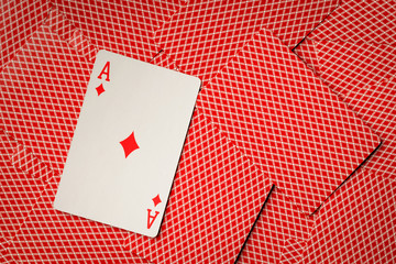 Ace diamonds on cards with red back background