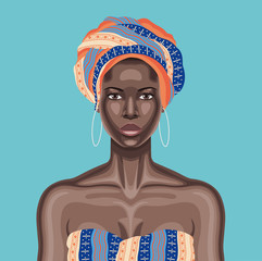 Young beautiful black woman with multicolor head wrap and white hoop earrings