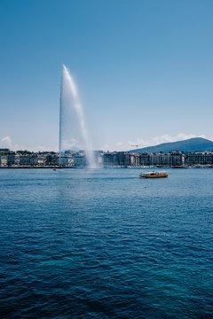 Fountain and boat on Lake Geneva