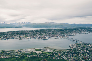 Above view of Tromso city in Northern Norway, cityscape from high Floya Hill at cloudy day.