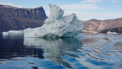 iceberg in front of fjords of Greenland