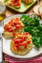 Oven baked chicken breasts topped with tomatoes and bell peppers