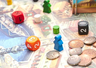 Cubes with the game on the table. themed Board games. vertical view of the Board game close-up.