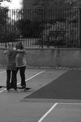 Two Friend Learning to Skateboard