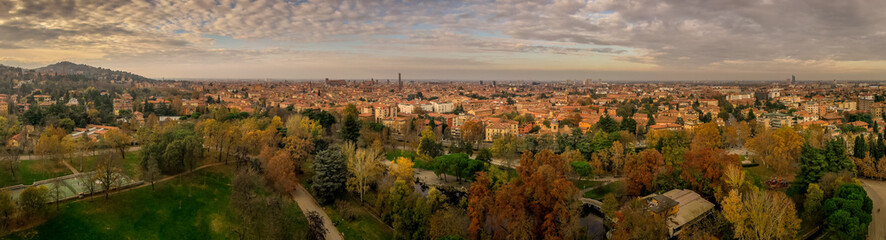Aerial panorama view of Bologna the capital city of Emilia Romagna province in Italy home to the best food and two leaning towers on a winter afternoon with sun set cloudy sky