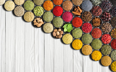 Fototapete - European Spices on white table background. Colorful condiments and herbs for Indian food