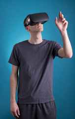Young man using VR Virtual Reality headset