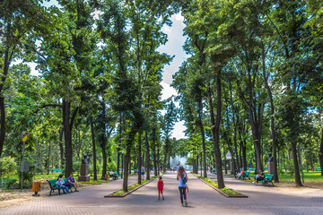 Chisinau, Moldavia - July 4th 2018 - Locals and tourists walking through a open air park with high...