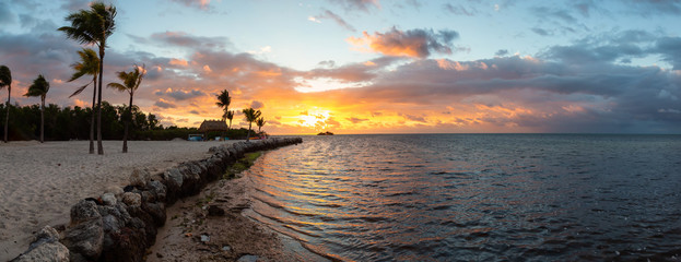 Striking sunrise viewed on a tropical sandy beach at the Atlantic Ocean Shore. Plantation Key, Florida Keys, Florida, United States. Wall mural