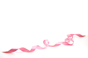 Curled Pink Ribbon On White