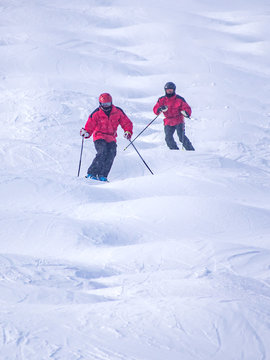 People are enjoying mogul skiing snow boarding