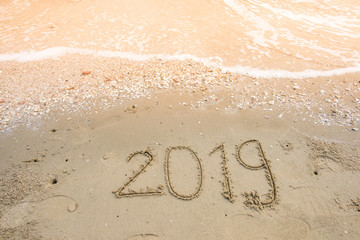 happy new year on sand background