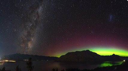 Aurora in New Zealand. Night sky image of southern lights and milky way galaxy in New Zealand