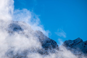 Some interesting clouds formation around a snow mountain in New Zealand.