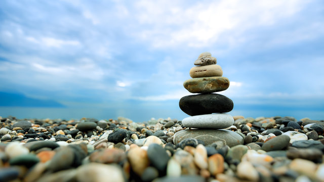 Stacked pebbles along the beach for nature background use