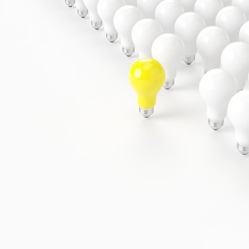 Think different. outstanding yellow light bulb with white light bulb on white background. minimal concept