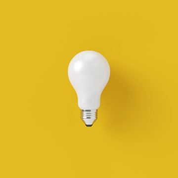 Minimal concept. outstanding white light bulb on yellow background