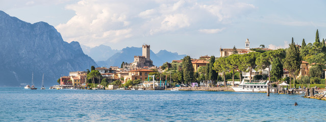 Idyllic coast in Italy: Blue water and a cute village at lago di garda, Malcesine Wall mural