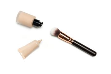 Foundation, concealer, make up brush on white background
