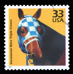 UNITED STATES OF AMERICA - CIRCA 1999: a postage stamp printed in USA showing an image of Secretariat the first racehorse to win the US Triple Crown, circa 1999.