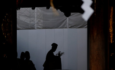 Shinto priest attends a ritual to usher in the upcoming New Year at Meiji Shrine in Tokyo