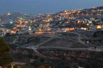 Jerusalem at dusk, night view of city hillside, Israel