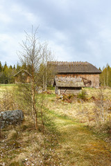 Old farmhouse in a rural landscape in the spring