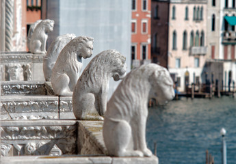 Venice, Italy, September 16, 2018 - The Lions on the balcony of the Ca de Ora Palace in Venice