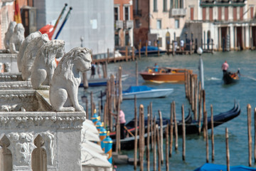 Venice, Italy, September 16, 2018 - Lions over the Grand Canal on the balcony of the Ca de Ora Palace in Venice