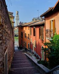 Verona, Italy, September 14, 2018 - The narrow street of Verona with colored houses